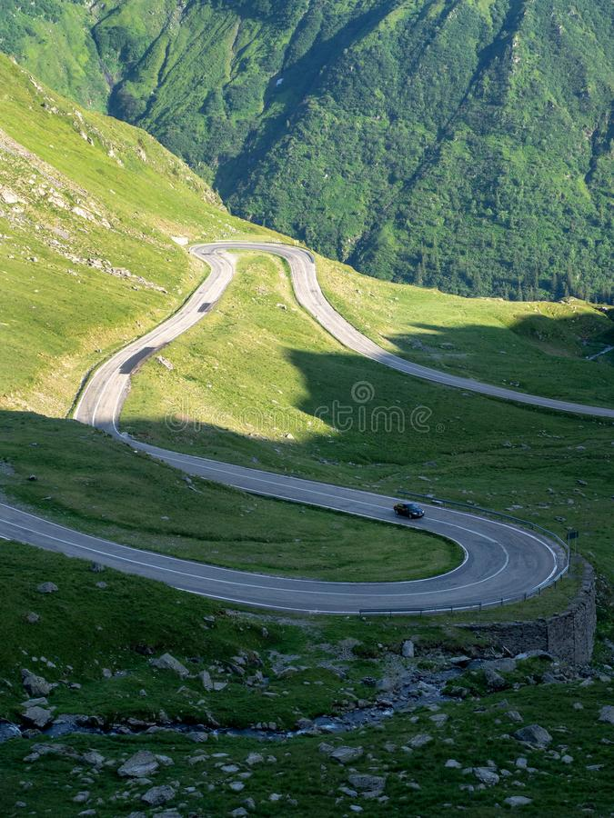 Mountain road crossing Carpathians, Romania stock image