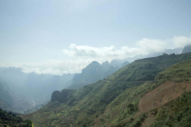 Mountain and road. In Van stone. Van Stone Plateau (natural or painted Van) is a rocky plateau spread over four districts of Quan Ba, Yen Minh, Van, Meo Vac, Ha stock photos