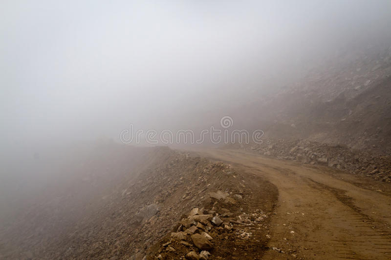 Download Mountain Road In The Fog Royalty Free Stock Photography - Image: 26963057