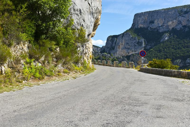 Mountain road in southeastern France. Mountain road between forests in Alpes-de-Haute-Provence department in southeastern France. Neighborhoods of a medieval royalty free stock images