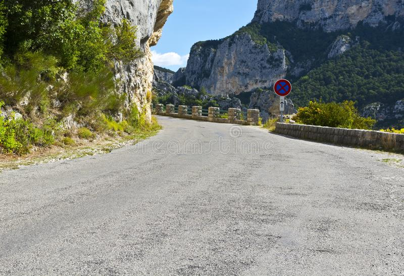 Mountain road in southeastern France. Mountain road between forests in Alpes-de-Haute-Provence department in southeastern France. Neighborhoods of a medieval royalty free stock photos