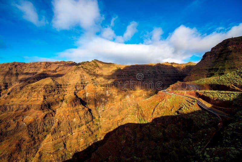 Mountain road on La Gomera island. Mountain road in the valley near Valle Gran Rey city on La Gomera island in Spain stock image