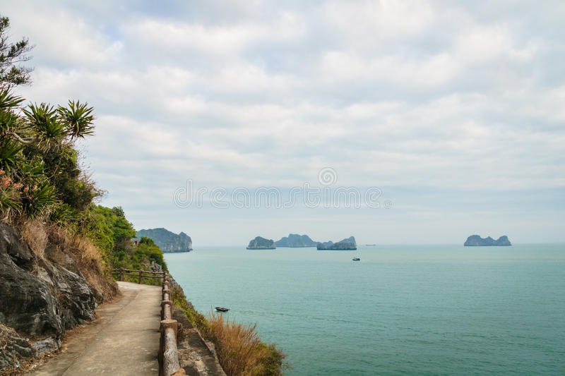 Mountain road by the ocean in Cat Ba, Ha long Bay, Vietnam, South East Asia. Hiking road by the ocean in Cat Ba, Ha long Bay, Vietnam, South East Asia royalty free stock photos