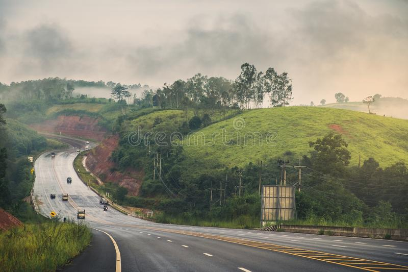 Mountain road after the rain. Misty morning sunrise and road after the rain in mountain at Khao-kho Phetchabun,Thailand royalty free stock photography