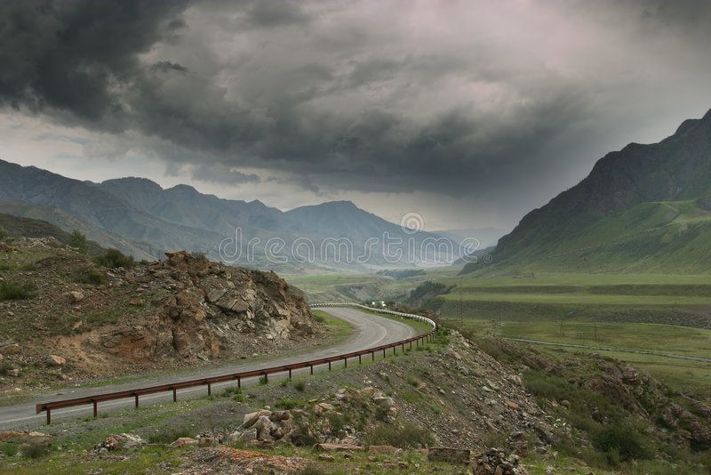 Mountain road before the storm royalty free stock photo