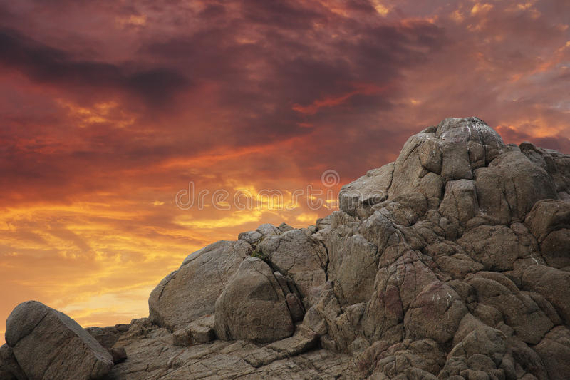 Mountain rock over sunset. Rock mountain cliff, sunset sky background stock image