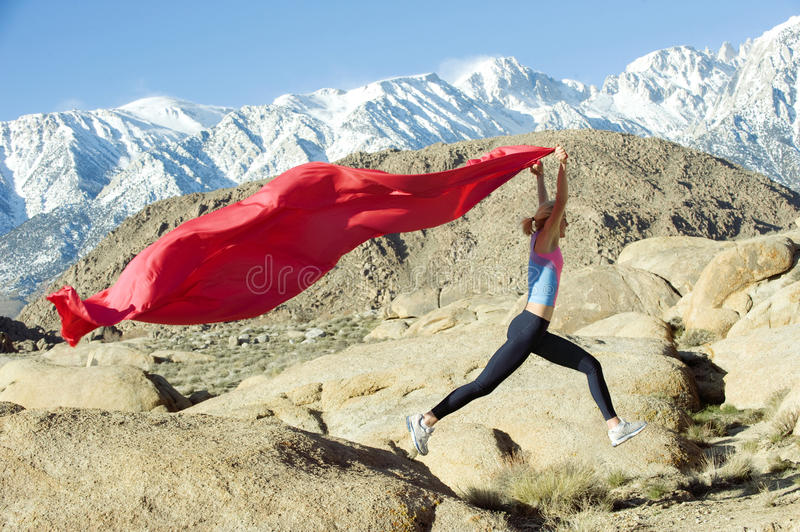 Mountain Runner With Flag Royalty Free Stock Images