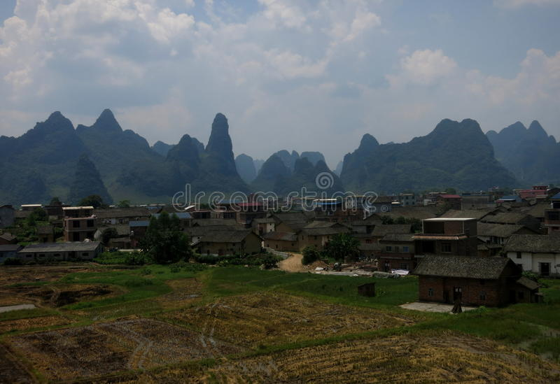 Mountain scenery surrounding Chinese little town stock photography