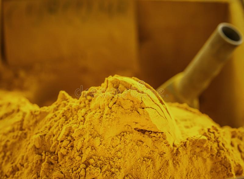 Mountain of scented golden tumeric spice powder displayed at a local farmers market in Sicily stock photos