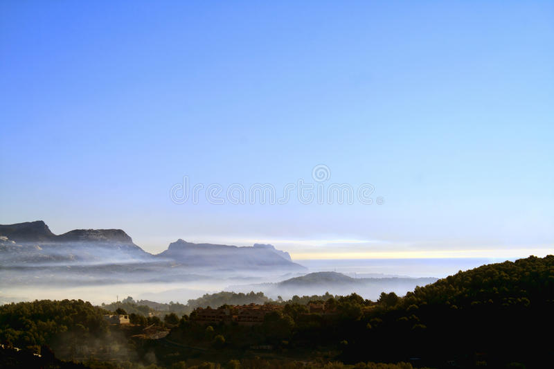 Download Mountain and sea mist stock image. Image of coast, clouds - 21583853