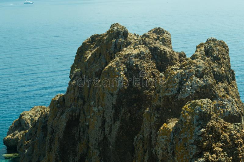 Mountain and sea. rocky cliff. Background royalty free stock photo