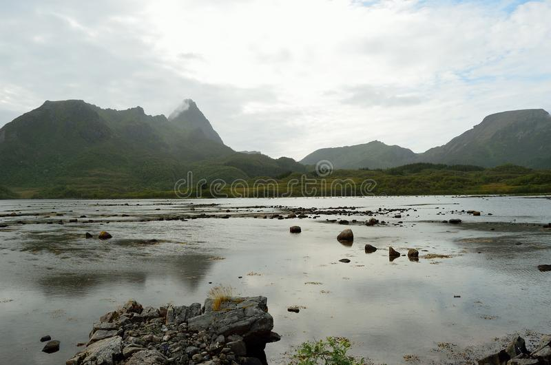 Mountain and sea water inland in vesteraalen royalty free stock images
