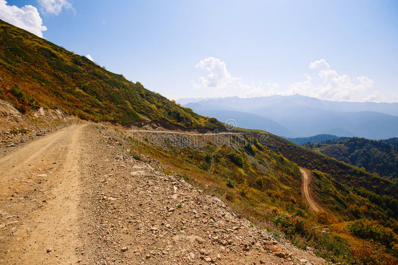 Mountain serpentine. Dirt road in the mountains. Country road in the mountains stock photo