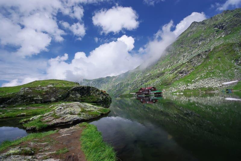 Mountain shelter. Near a lake in Romanian Carpathians - Balea lake royalty free stock photos