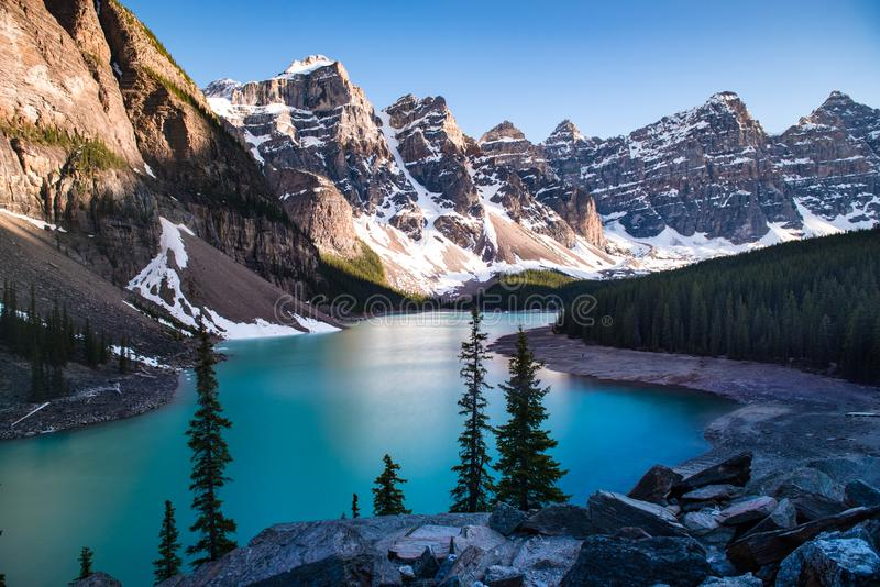 Mountain shadow at sunset over Moraine Lake stock photo