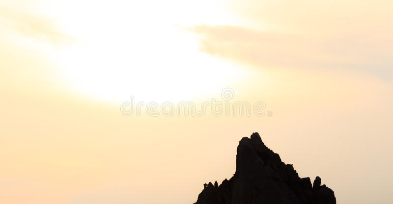 Mountain silhouette over golden sunset. stock image