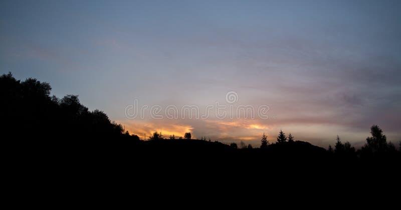 Mountain. Silhouette of mountain under sunset stock photo