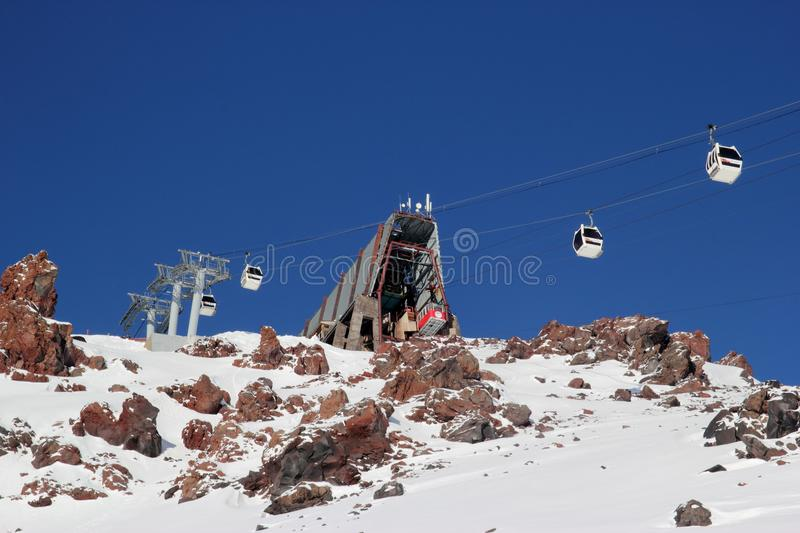 Mountain ski resort Elbrus Russia, gondola lift, landscape winter mountains. Nature and sport background, landscape winter mountains, glacier royalty free stock images
