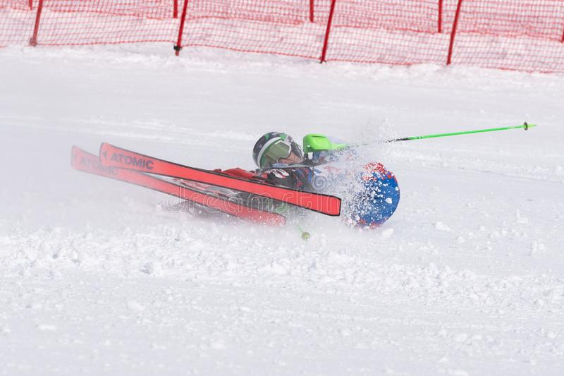 Mountain skier falling down on mountain slope. Russian Alpine Skiing Cup, slalom. MOROZNAYA MOUNTAIN, KAMCHATKA, RUSSIA - MARCH 28, 2019: Russian Alpine Skiing stock photos