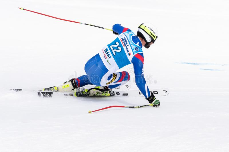Mountain skier skiing down mount slope. Russian Alpine Skiing Championship, giant slalom. KAMCHATKA PENINSULA, RUSSIAN FEDERATION - APRIL 2, 2019: Russian Men\'s royalty free stock photography