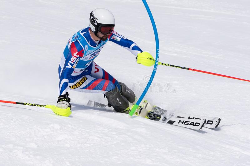 Mountain skier skiing down mount slope. Russian Alpine Skiing Cup, slalom. MOROZNAYA MOUNT, KAMCHATKA PENINSULA, RUSSIA - MAR 28, 2019: Russian Alpine Skiing Cup stock images