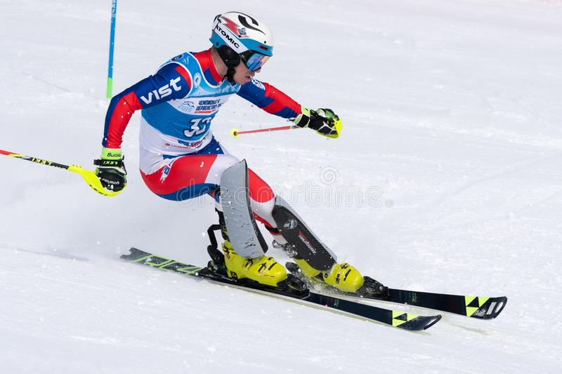 Mountain skier skiing down mount slope. Russian Alpine Skiing Cup, slalom. MOROZNAYA MOUNT, KAMCHATKA, RUSSIA - MARCH 28, 2019: Mountain skier Nazar Chernov ( royalty free stock photo
