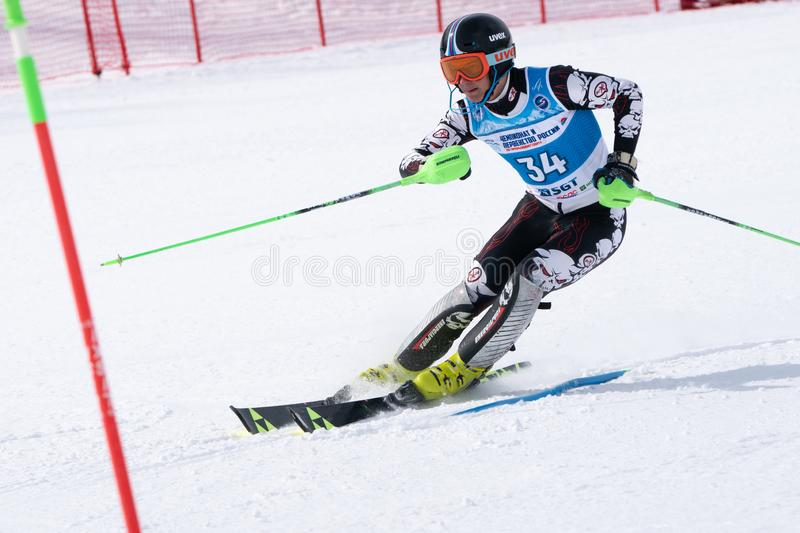 Mountain skier skiing down mountain slope. Russian Alpine Skiing Cup, slalom. MOROZNAYA MOUNT, KAMCHATKA PENINSULA, RUSSIA - MAR 28, 2019: Russian Alpine Skiing royalty free stock photo