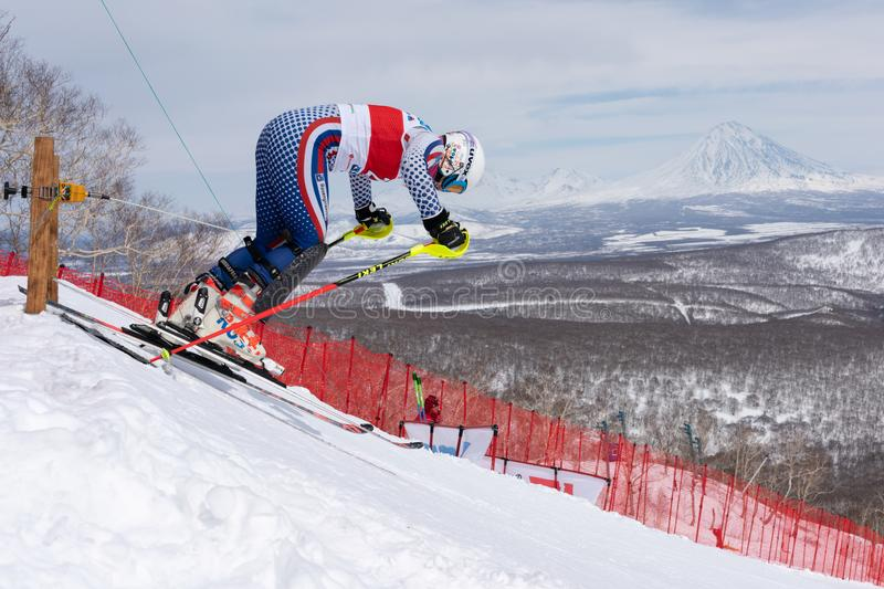 Mountain skier at start skiing down. Russian Alpine Skiing Championship, slalom. MOROZNAYA MOUNTAIN, KAMCHATKA PENINSULA, RUSSIA - MARCH 28, 2019: Mountain skier stock images