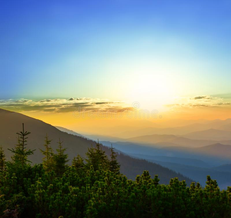 Mountain slope in a blue mist at the sunset stock photos
