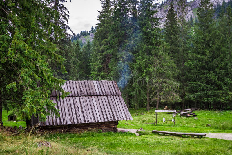 Mountain smokehouse in the forest royalty free stock photography