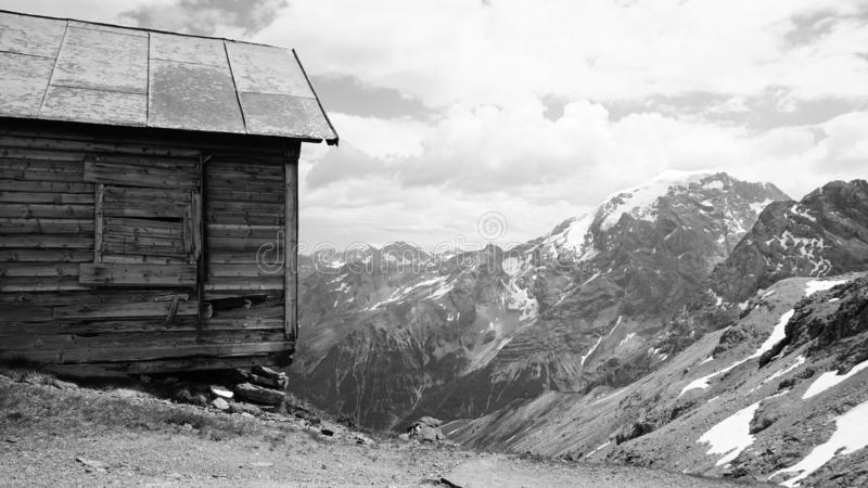 Mountain, snow, black and white, stelvio, wooden house, nook. A chalet/wooden nook in the alps in the mountains in a snowy landscape stock photography