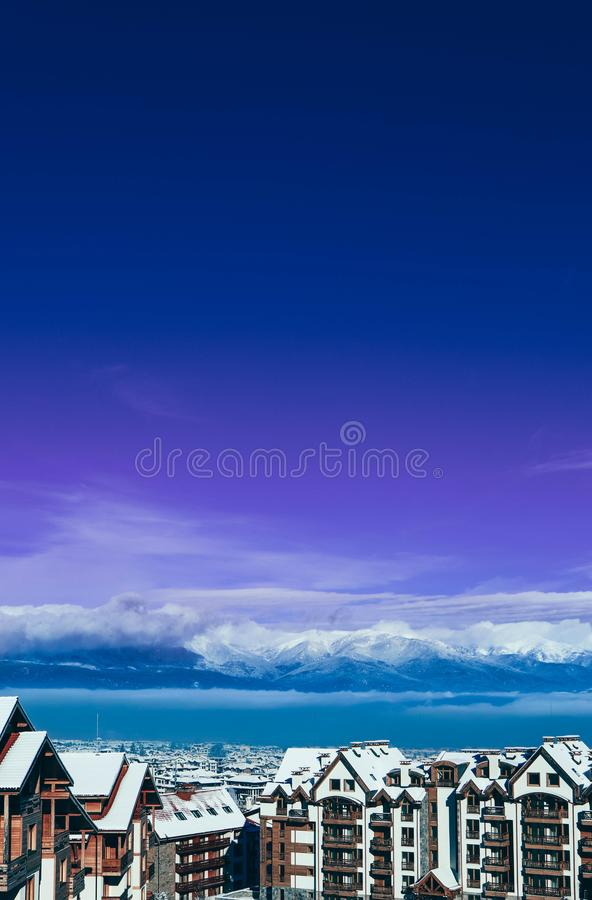 Mountain snow peak, Alpine village houses. Europe, old town winter ice hill top panoramic view. royalty free stock images