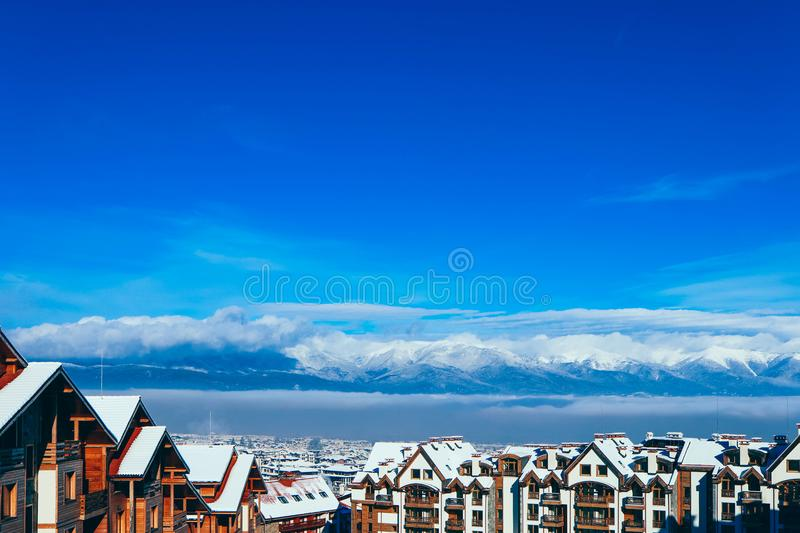Mountain snow peak, Alpine village houses. Europe, old town winter ice hill top panoramic view. royalty free stock photo
