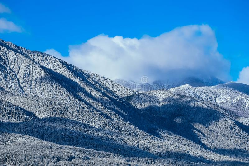 Mountain snow peak, beautiful natural winter backdrop. Ice top o royalty free stock photography