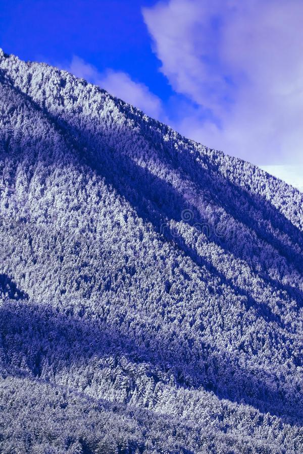 Mountain snow peak, beautiful natural winter backdrop. Ice top o stock photography