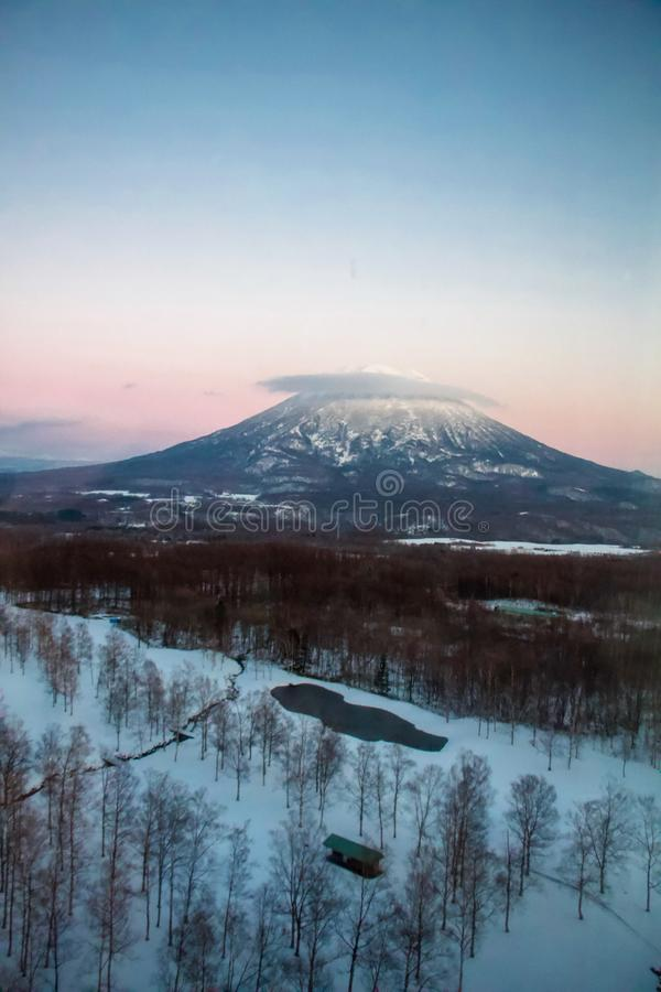 Mountain in snow winter. Snow mountain in winter with the sunset sky in pick stock photo