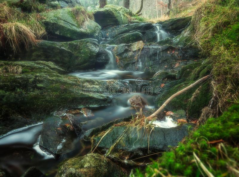 Mountain stream cascadind down the rocks royalty free stock photos