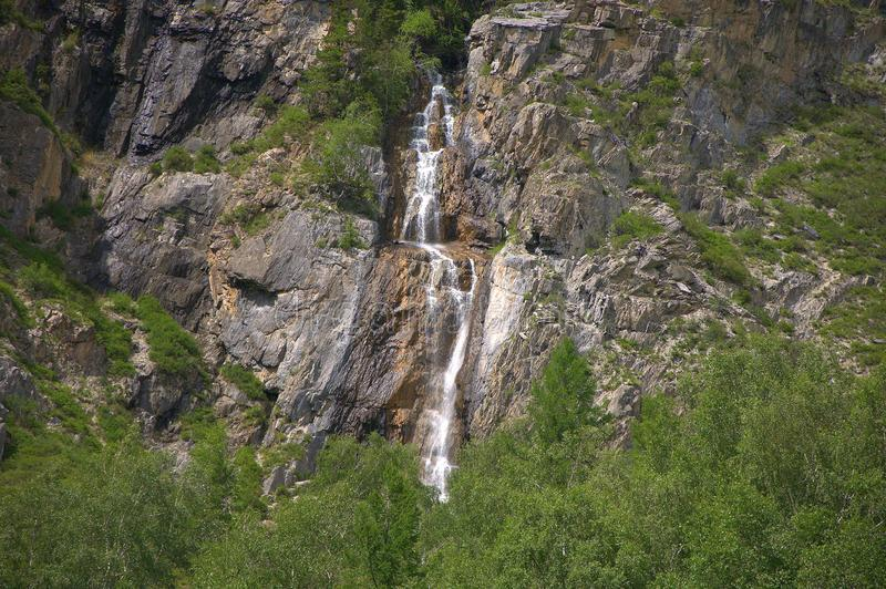 Mountain stream flowing down a waterfall into the valley. Altai, Siberia, Russia. Landscape royalty free stock photos