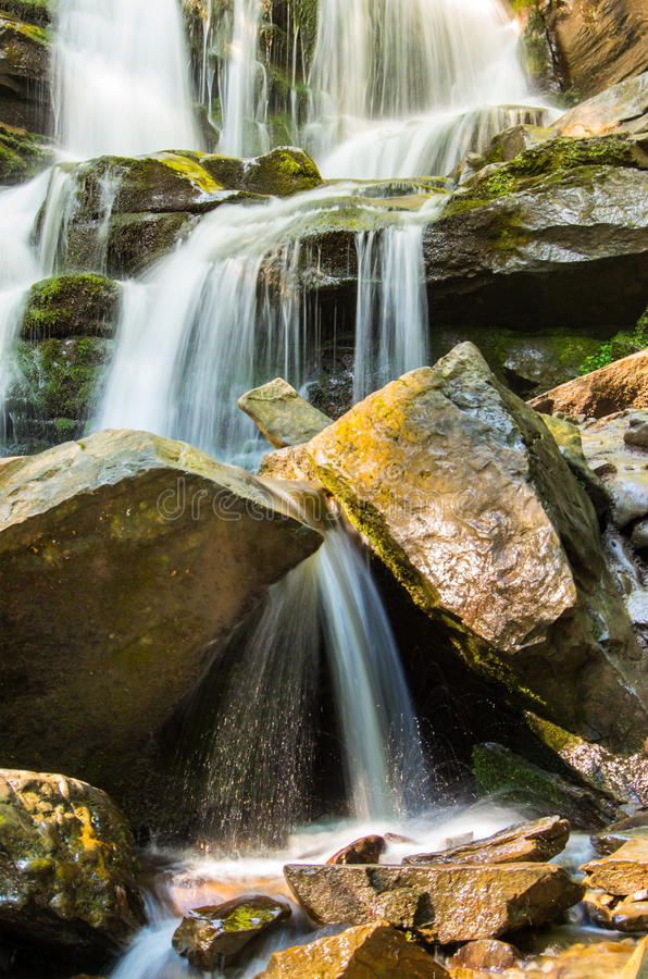 Mountain stream on the rocks. royalty free stock images