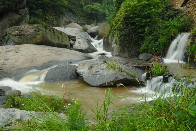 Mountain Streams. Mountain stream, gurgling water in different poses and with different expressions.Small waterfall stock photos
