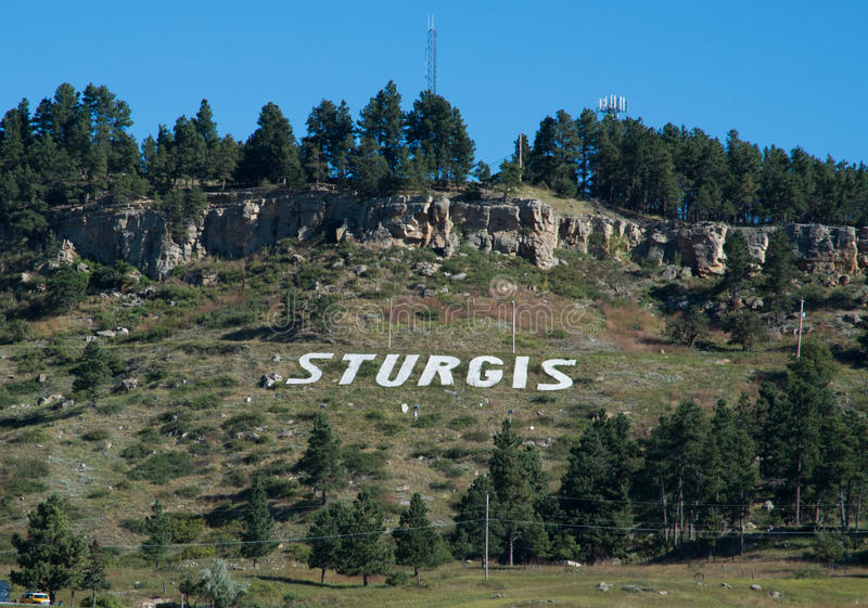 Mountain with STURGIS in white. Hillside above Sturgis South Dakota stock image