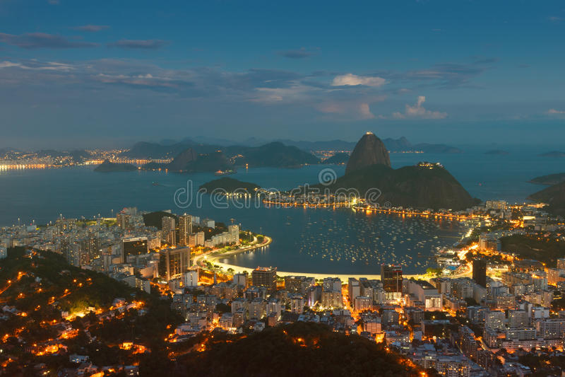Mountain Sugarloaf, Rio de Janeiro, Brazil. Mountain Sugarloaf and Guanabara bay from viewpoint dona Marta, night view, Rio de Janeiro, Brazil. Toning effect stock photos