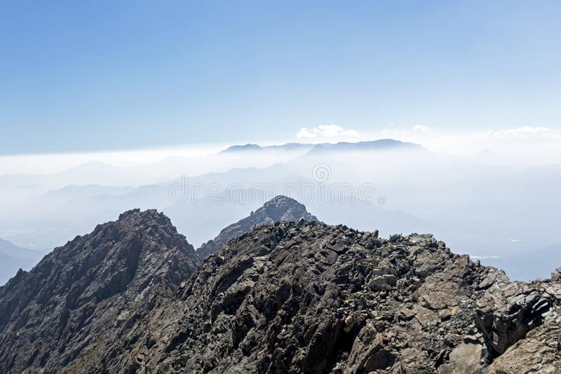 Mountain summit view with landscape of Andes and Aconcagua on clear day in La Campana National park in central Chile, South stock image