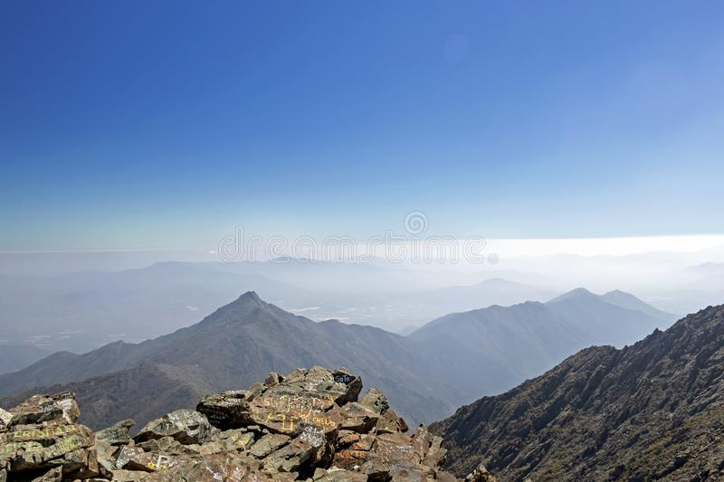 Mountain summit view with landscape of Andes and Aconcagua on clear day in La Campana National park in central Chile, South royalty free stock photography