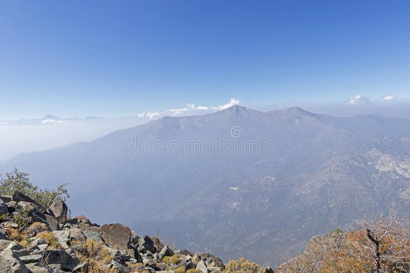 Mountain summit view with landscape of Andes and Aconcagua on clear day in La Campana National park in central Chile, South royalty free stock photos