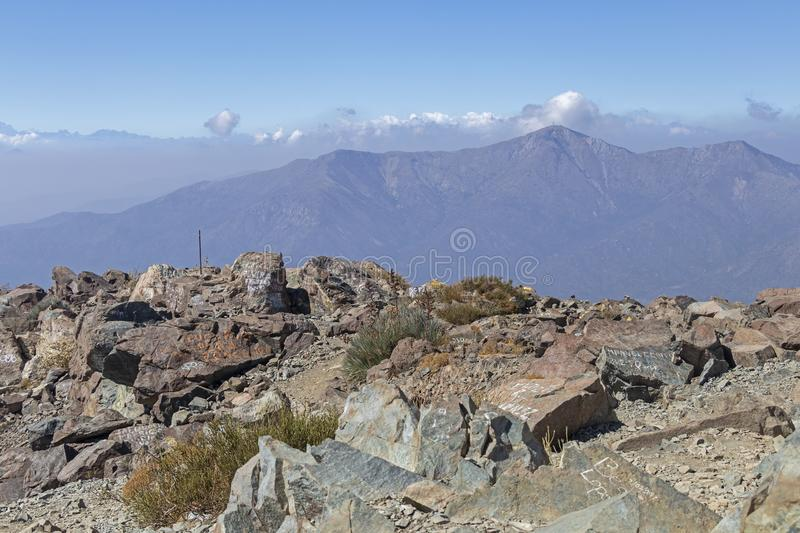 Mountain summit view with landscape of Andes and Aconcagua on clear day in La Campana National park in central Chile, South royalty free stock images