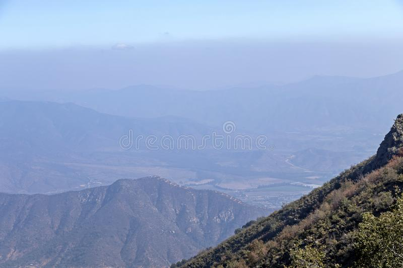 Mountain summit view with landscape of Andes and Aconcagua on clear day in La Campana National park in central Chile, South stock photography
