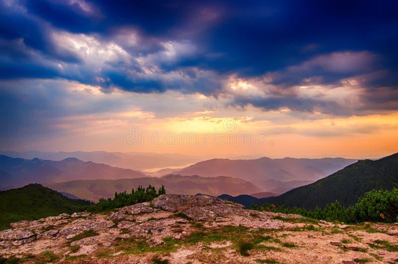Mountain sunrise landscape. Carpathian mountains summer sunrise landscape with dramatic sky, rocks and sun shining royalty free stock photo