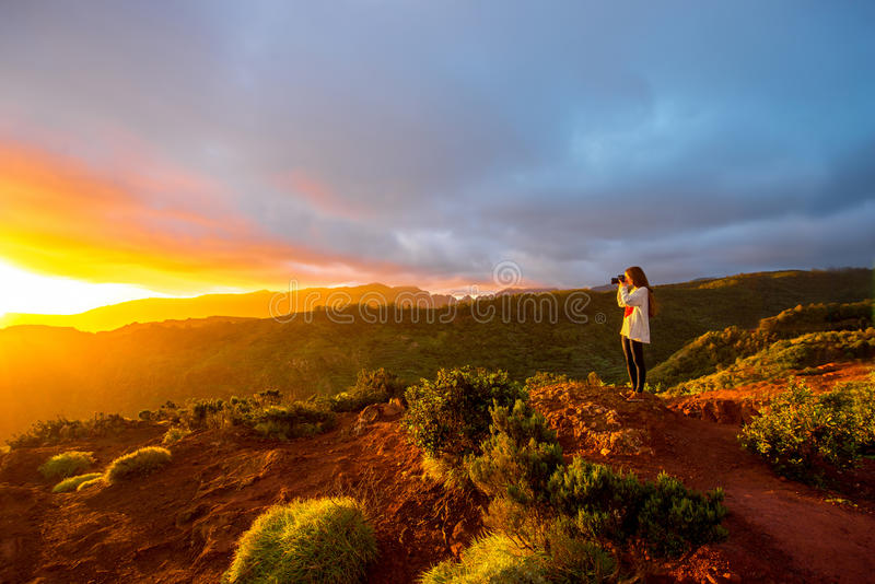 Mountain sunrise view on La Gomera island. Beautiful landscape view near mirador de Abrante on La Gomera island with woman enjoying the sunrise royalty free stock photos