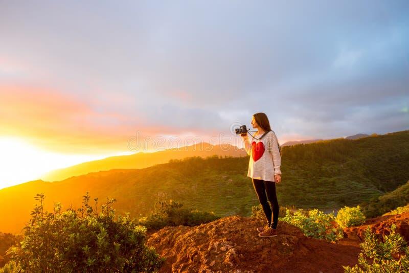 Mountain sunrise view on La Gomera island. Beautiful landscape view near mirador de Abrante on La Gomera island with woman enjoying the sunrise stock photo